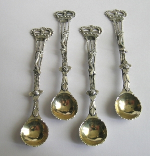 Royal Commemorative: A George III set of four silver salt spoons